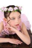 Ballet Girl. Brunette ballet girl against a white background wearing pink Royalty Free Stock Image