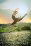 Ballet girl dancer jump at sunset royalty free stock images