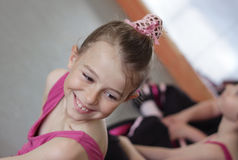 Ballet girl with friends during ballet lesson. Young girl laughing with her friends during her ballet lesson Stock Photo