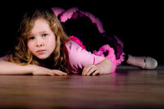 Ballet girl is laying down Royalty Free Stock Image