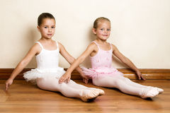 Ballet Girls. Young ballet dancers in a studio with wooden floors Royalty Free Stock Photo