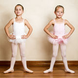Ballet Girls. Young ballet dancers in a studio with wooden floors Royalty Free Stock Photography