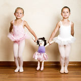 Ballet Girls. Young ballet dancers in a studio with wooden floors Royalty Free Stock Images