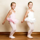 Ballet Girls. Young ballet dancers in a studio with wooden floors Royalty Free Stock Image