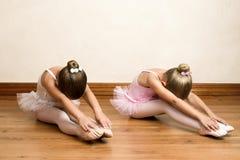 Ballet Girls. Young ballet dancers in a studio with wooden floors Stock Photo