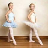 Ballet Girls. Young ballet dancers in a studio with wooden floors Stock Images