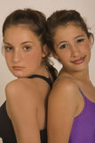 Ballet and Gym girls in portrat. Portrat of 2 girls in gym and ballet clothes in studio Stock Photos