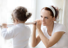 Ballet instructor directs little  ballerina during dance practi Stock Photography