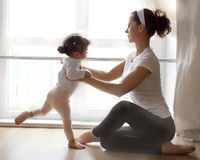 Ballet instructor directs little  ballerina during dance practi Stock Photo