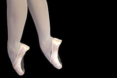 Ballet legs isolated on black Stock Photography