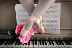 Ballet Legs in Pointe on Piano Royalty Free Stock Photo