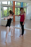 Ballet lesson in progress with student and teacher Royalty Free Stock Image