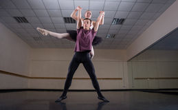 Ballet partners dancing gracefully together Stock Photos
