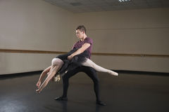 Ballet partners dancing gracefully together Royalty Free Stock Image