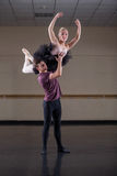 Ballet partners dancing gracefully together Stock Photography