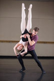 Ballet partners dancing gracefully together Royalty Free Stock Photos