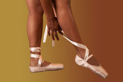 Ballet pointes. Ballerina putting on her ballet pointes for performance Royalty Free Stock Photos