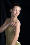Ballet Portrait. A portrait of a ballerina in half length lookijng back over left shoulder.  Lighting leans more to the dramatic with heavier shadows on face  to Stock Images