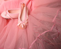 Ballet Pumps. Pink Ballet costume and miniature shoes with bows Stock Photos