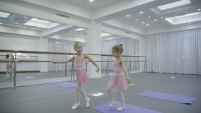 In ballet school children play and dance funny and move their hands. Little children in skirts are happy and fun to behave during dance stock video footage