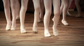 Ballet school fragment with little girls legs. The ballet school fragment with little girls legs on pointes Royalty Free Stock Images
