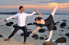 Ballet by the sea. Young asians performing ballet by the sea as a pair Stock Photo