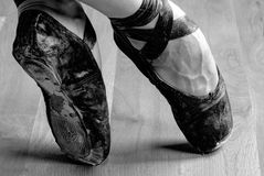 Ballet Shoe. Well Worn Black Ballet Shoe, Black and White in studio Stock Photography