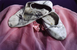Ballet shoes. Still life of worn ballet slippers and tutu. Interesting textures royalty free stock image