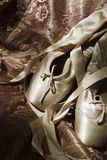 Ballet Shoes. A pair of ballet shoes lying on material Stock Photo