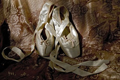Ballet shoes. A pair of ballet shoes lying on material Stock Photography
