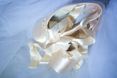 Ballet shoes. Pink Ballet shoes on blue voile stock photos