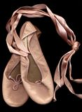 Ballet shoes. A pair of pink ballet shoes on black background Royalty Free Stock Photo