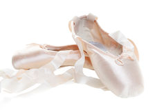 Ballet shoes. Pink ballet shoes isolated on a white background, Focus on the front shoe royalty free stock image