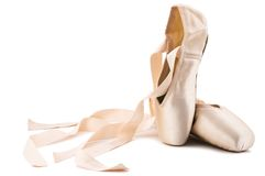 Ballet shoes. Brand new ballet shoes on a white background royalty free stock image