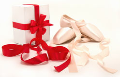 Ballet shoes. And a gift with red ribbons stock photo