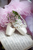 Ballet shoes. Composition with ballet shoes on the score and bouquet of Hrisantemas stock photos