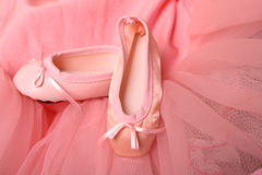 Ballet Shoes. Pink Ballet costume and miniature ballet shoes Stock Photos