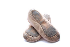 Ballet shoes. A used pair of a child\'s ballet shoes isolated on a white background Royalty Free Stock Image