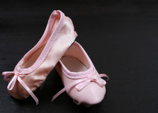 Ballet Shoes on black Stock Images