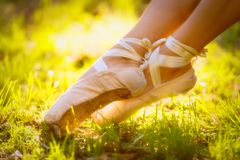 Ballet shoes. Ballet dancer outside. Ballet shoes. Sunny day stock photo