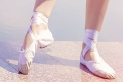 Ballet shoes for dancing shod on their feet dancer girls royalty free stock photo