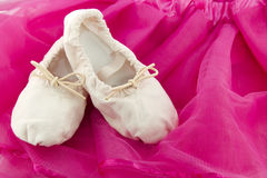 Ballet shoes of a girl on pink background Stock Photos