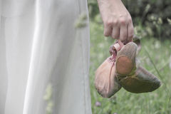 Ballet shoes in the hand of the girl Royalty Free Stock Photos