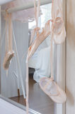 Ballet shoes hang on bar Stock Image