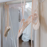 Ballet shoes hang on bar Stock Photography