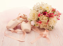 Ballet shoes. Pointe shoes on wooden background. royalty free stock photos