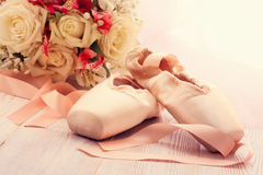 Ballet shoes. Pointe shoes on wooden background. stock photos