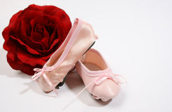 Ballet Shoes and Rose. One Leather and one satin ballet shoe with a rose Royalty Free Stock Photography