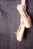 Ballet shoes on a wooden background Stock Image