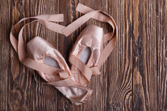 Ballet shoes on wooden background Stock Images